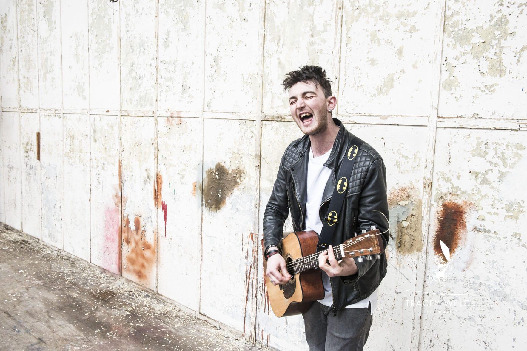 Josh Robins with guitar, Leeds